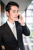 istock businessman standing in the office corridor 609694406