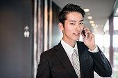 istock businessman standing in the office corridor 609694920