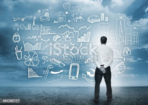 istock Businessman standing looking at detailed business flowchart 494280127