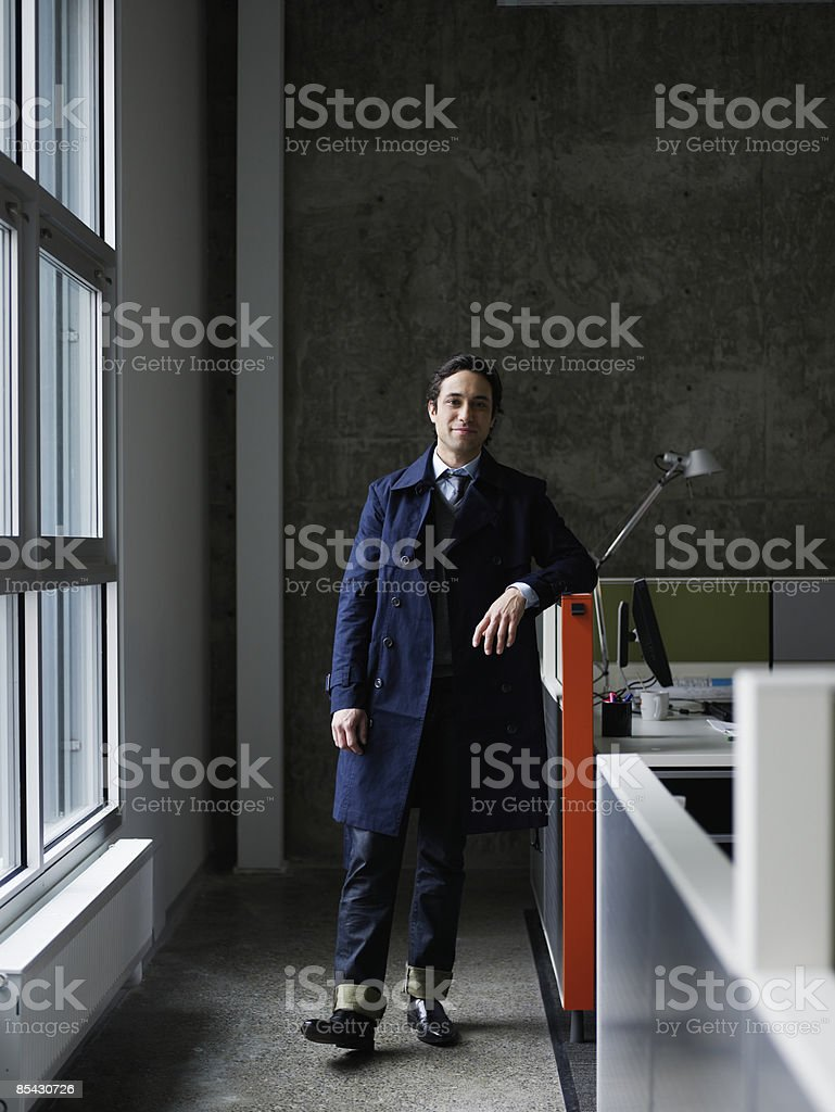 Businessman standing  next to workstation royalty-free stock photo