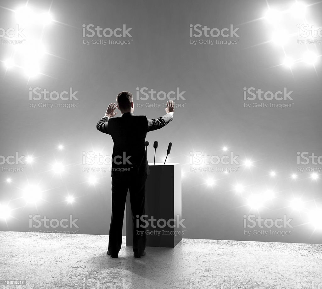 businessman standing on podium royalty-free stock photo