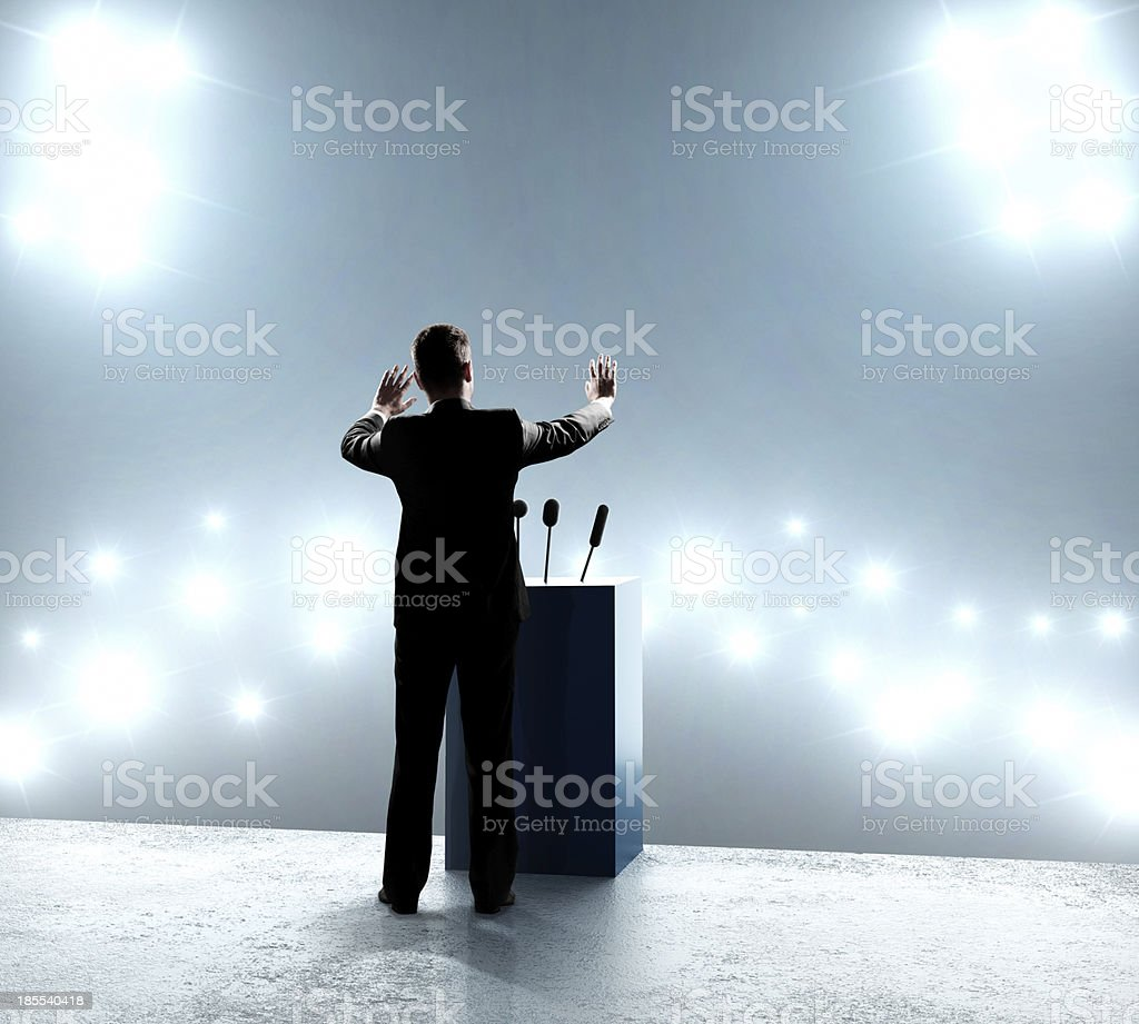 businessman standing on podium royalty-free stock photo