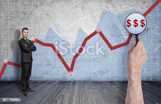 611747524istockphoto Businessman standing on the background of rising diagram 607756884