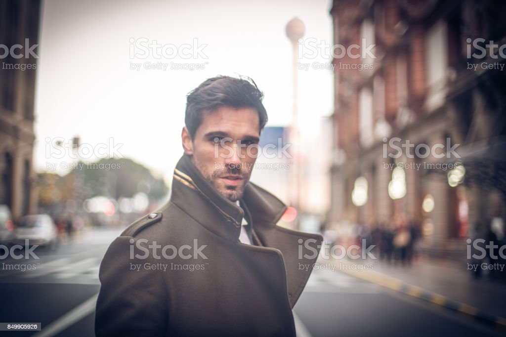 Businessman standing on the street stock photo