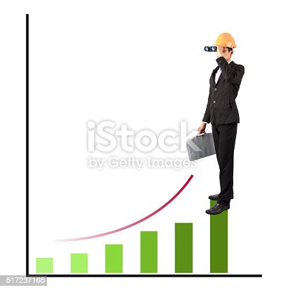 511722788 istock photo businessman standing on the top of financial charts 517237165
