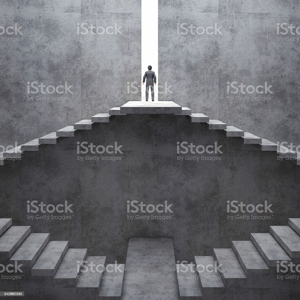 Businessman standing on top of concrete stairs. stock photo