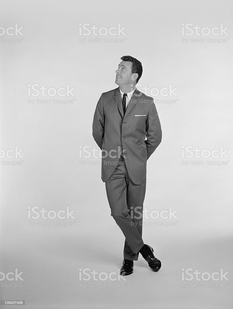 Businessman standing on white background, smiling stock photo
