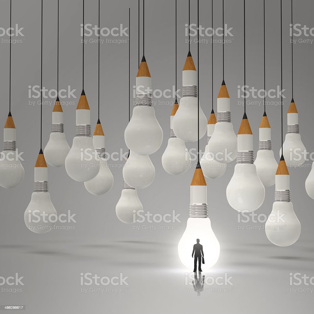 businessman standing out of  3d pencil and light bulb royalty-free stock photo