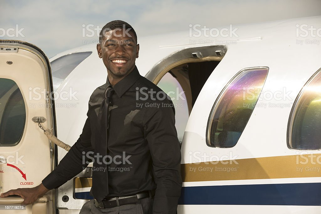 Businessman Standing Outside of Corporate Jet royalty-free stock photo