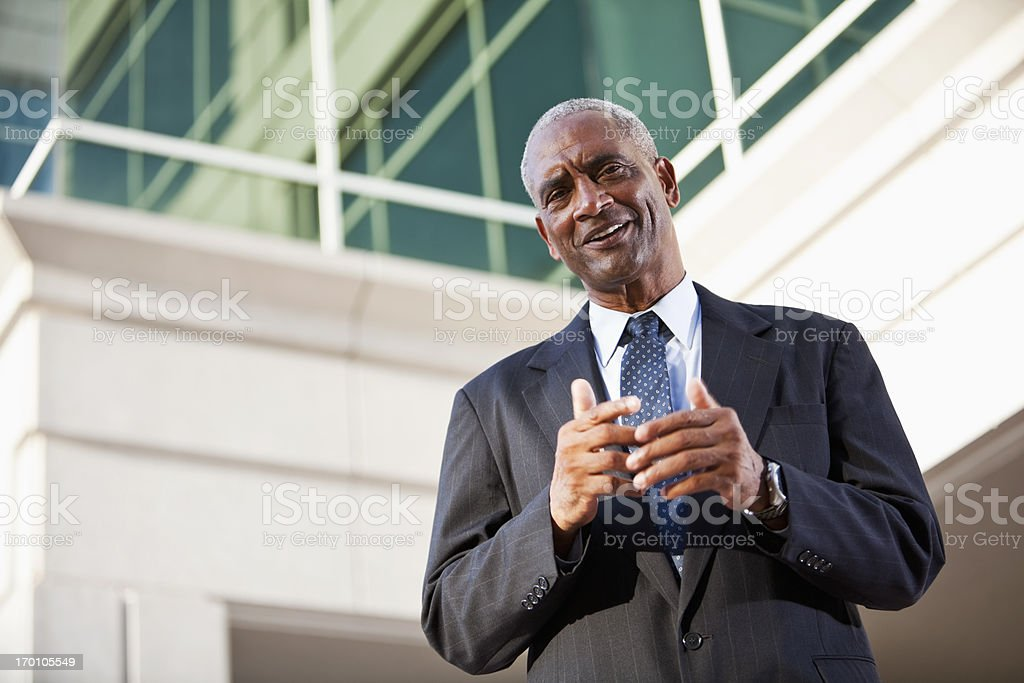 Businessman standing outside office building royalty-free stock photo