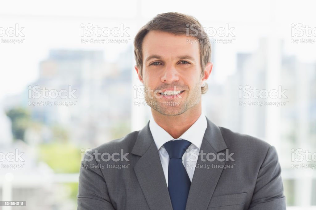Businessman standing over blurred background outdoors stock photo