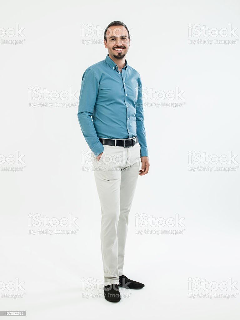 Businessman standing over white background stock photo