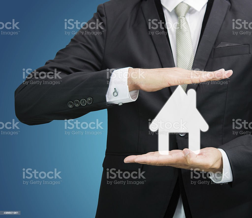 Businessman standing posture hand holding house icon isolated royalty-free stock photo