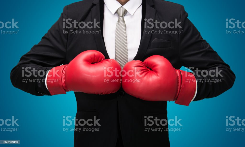 Businessman standing posture in boxing gloves stock photo