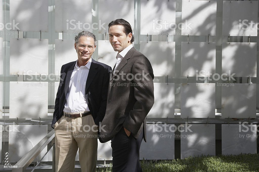 Businessman standing together outdoors royalty-free stock photo