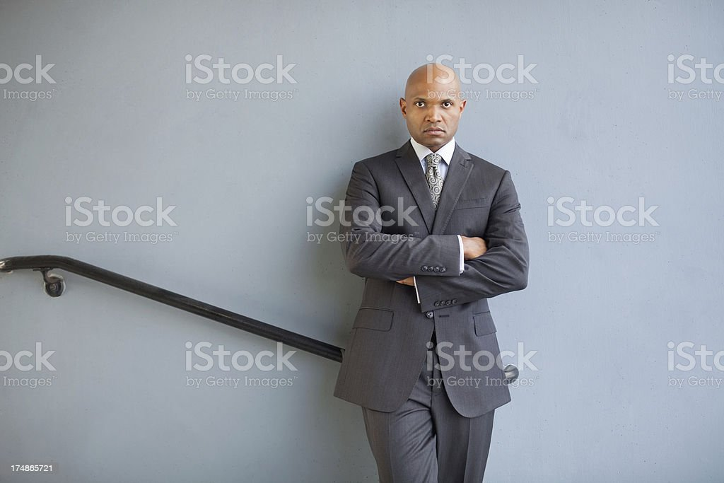Businessman Standing With Arms Crossed royalty-free stock photo