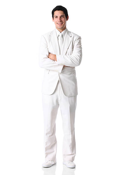 businessman standing with arms crossed - white suit stock photos and pictures