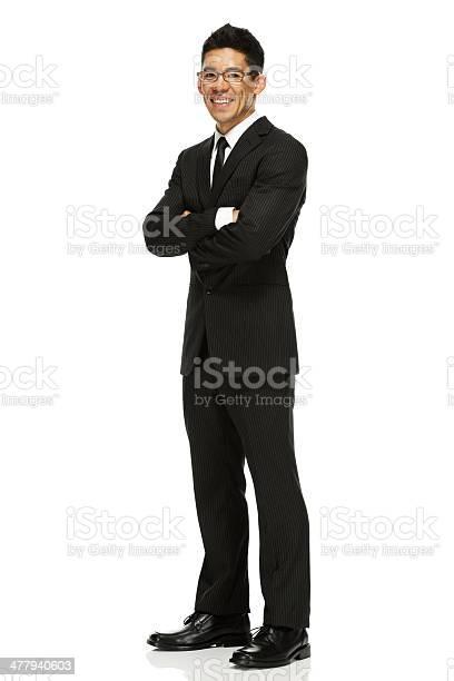ビジネスマン立つ腕を組む - 1人のストックフォトや画像を多数ご用意