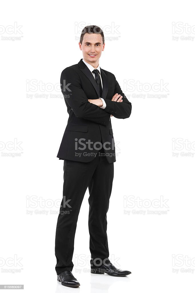 Businessman standing with arms crossed stock photo