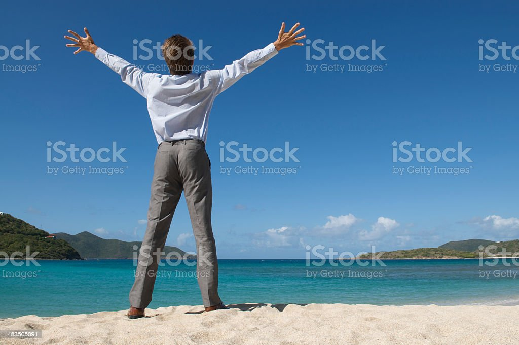 Businessman Standing With Arms Wide Open Tropical Beach stock photo
