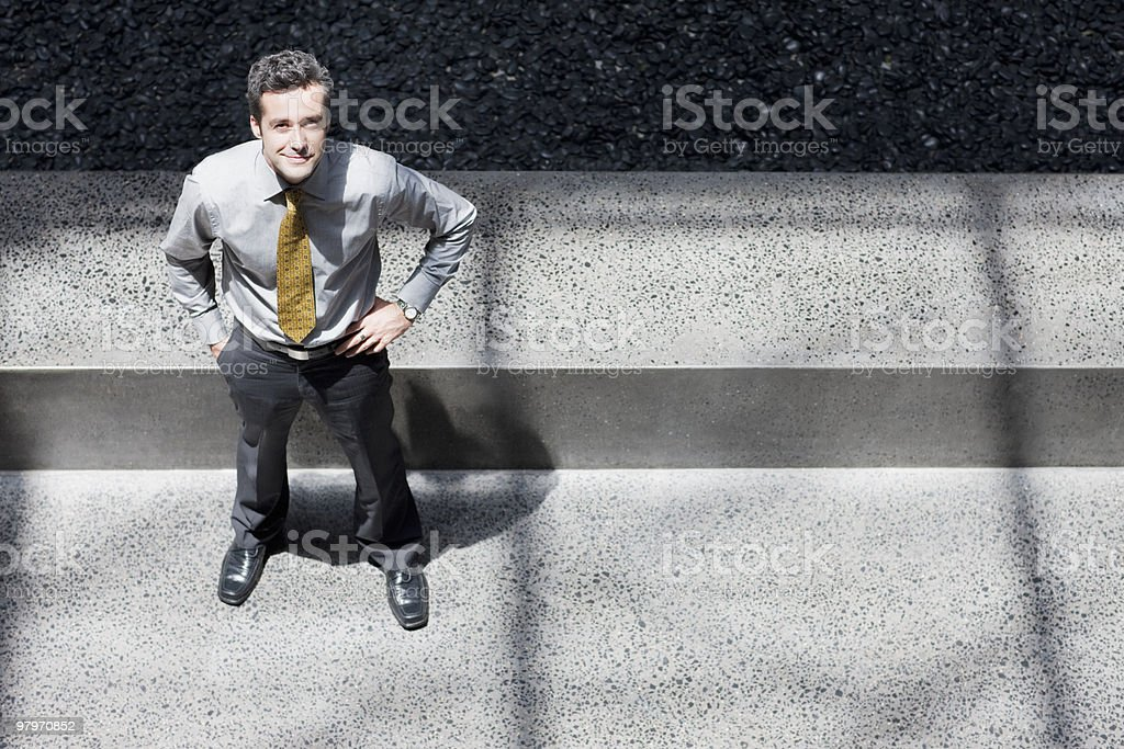 Businessman standing with hands on hips royalty-free stock photo