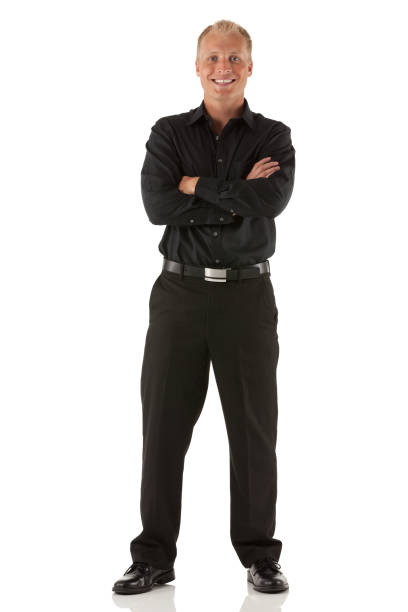 Businessman standing with his arms crossed stock photo