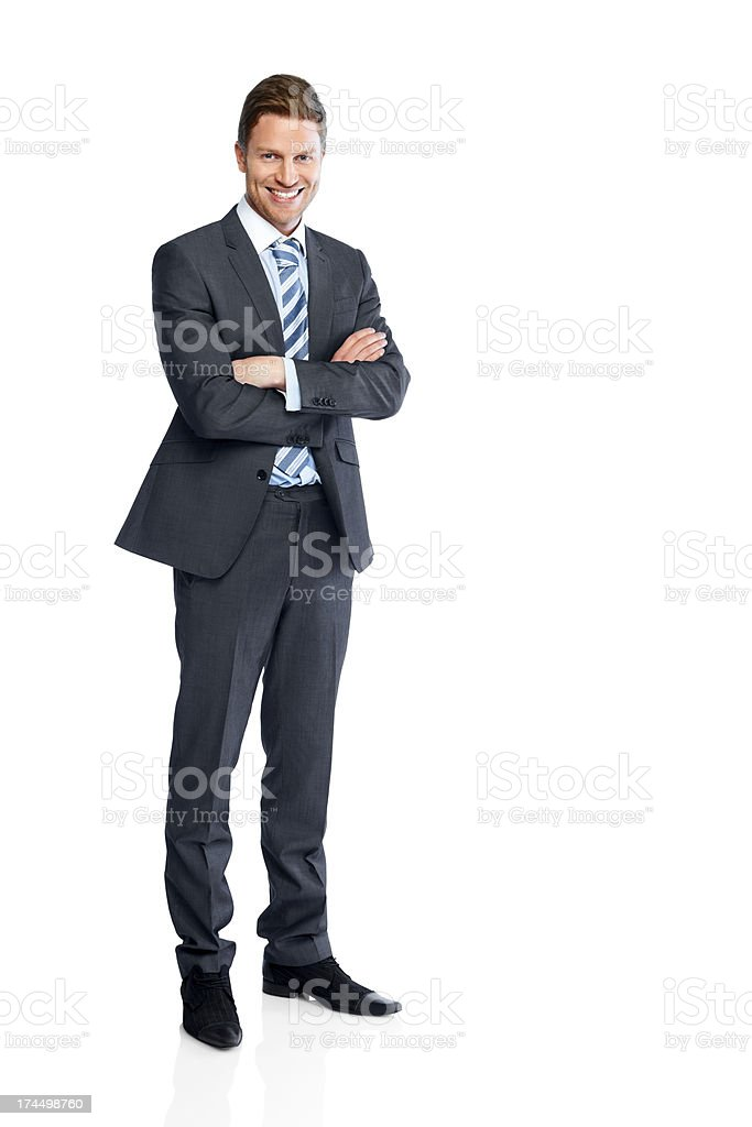 Businessman standing with his arms folded on white stock photo
