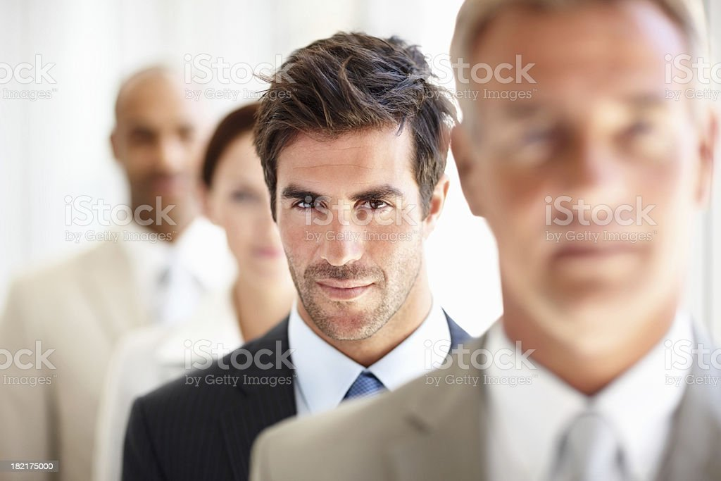 Businessman standing with his colleagues royalty-free stock photo