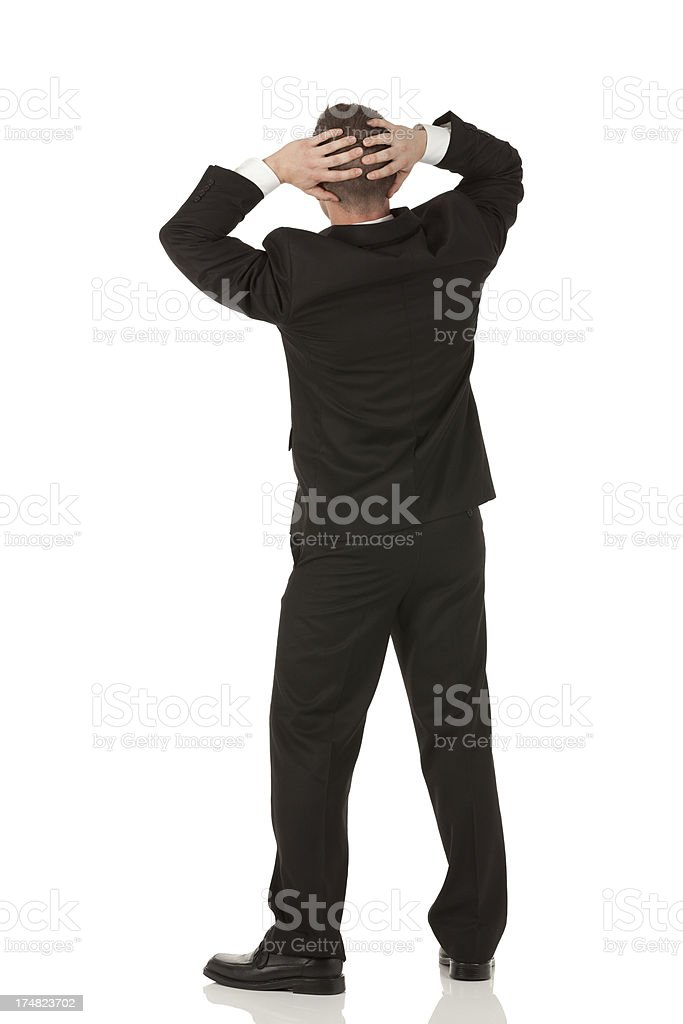 Businessman standing with his hands behind head royalty-free stock photo