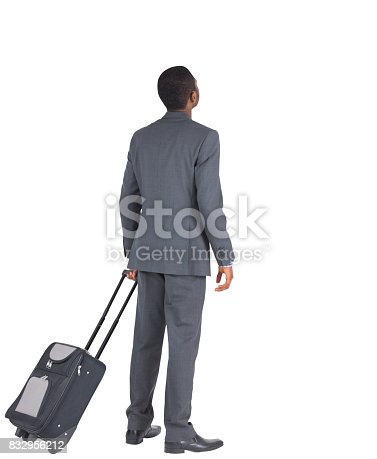 istock Businessman standing with his suitcase 832956212