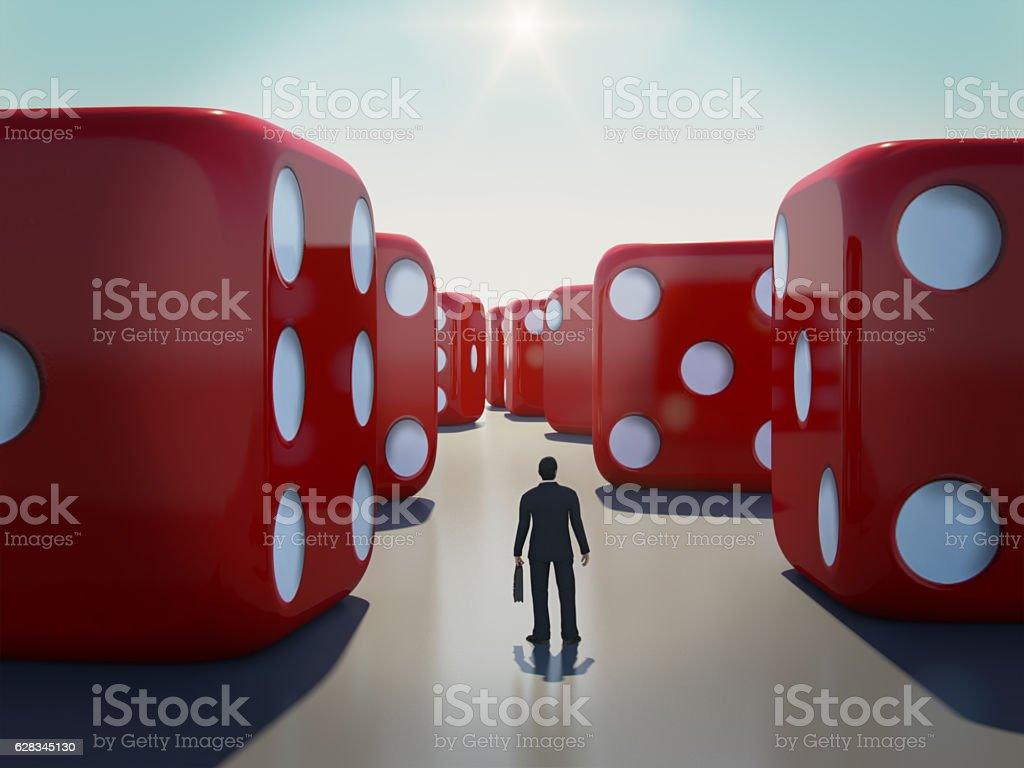 Businessman standing with rolling dice around,Business risk concep stock photo