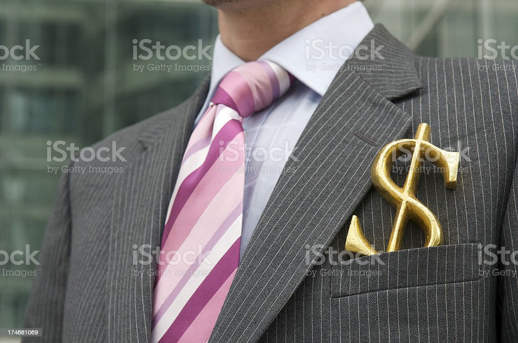 Businessman Stands Outdoors with Golden Dollar in Pocket stock photo