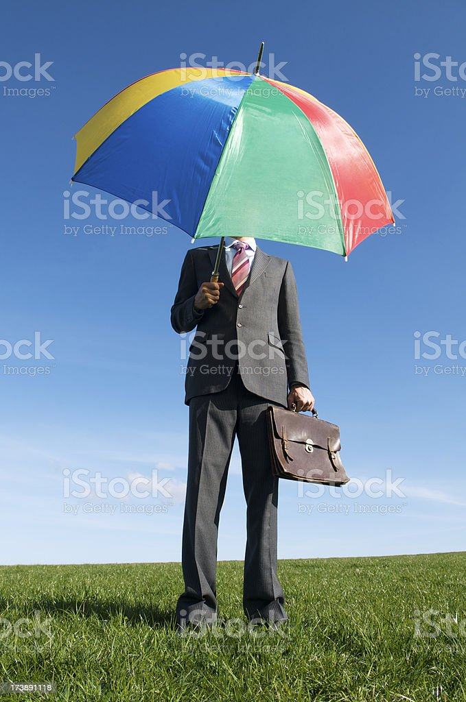 Businessman Stands under Colorful Umbrella royalty-free stock photo