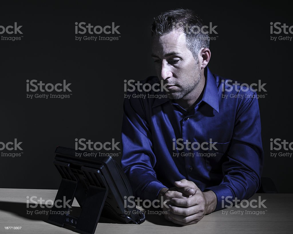 Businessman Staring at Phone royalty-free stock photo