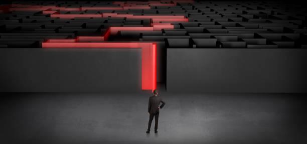 Businessman starting a stated dark labyrinth stock photo