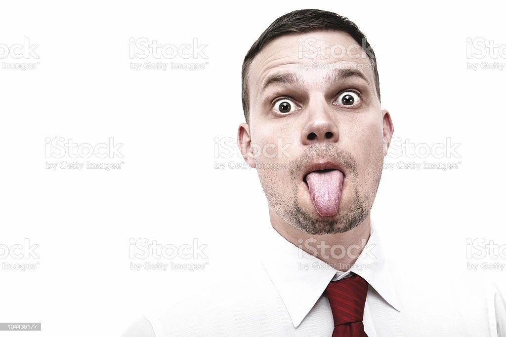 businessman sticking out his tounge royalty-free stock photo