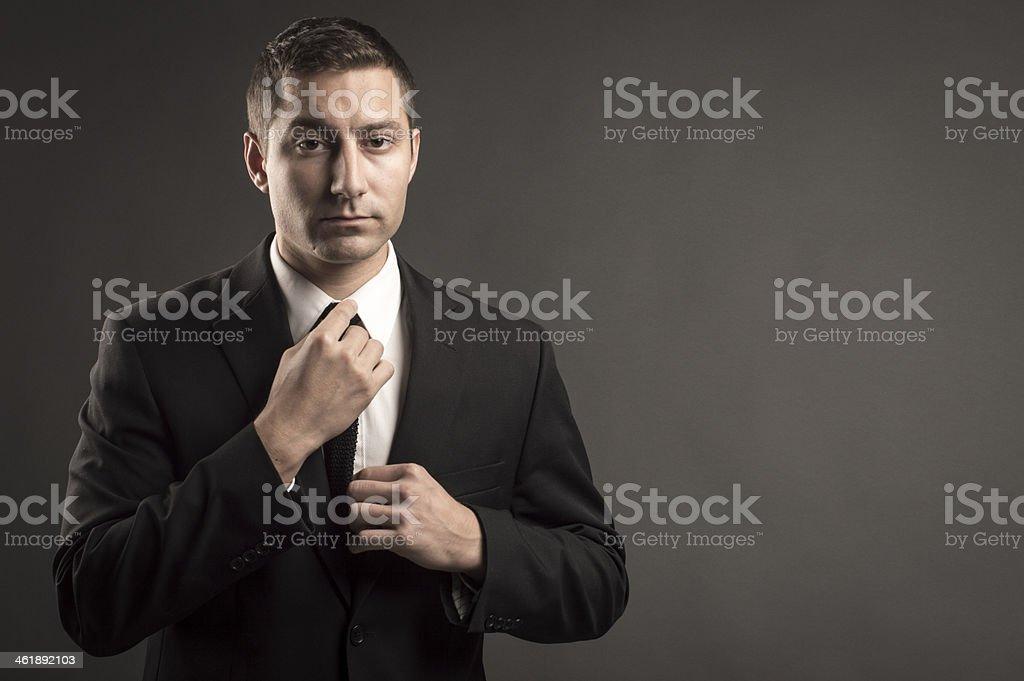 Businessman Straightening Tie stock photo