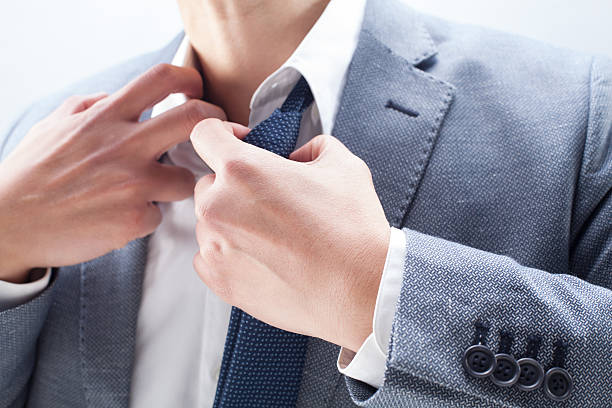 Businessman Stress Businessman loosening necktie at the desk. undressing stock pictures, royalty-free photos & images