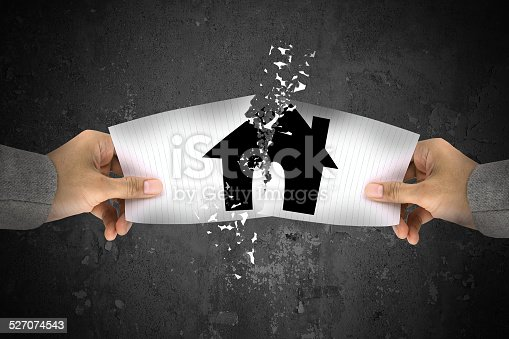 istock Businessman stress, ripping up a house paper 527074543