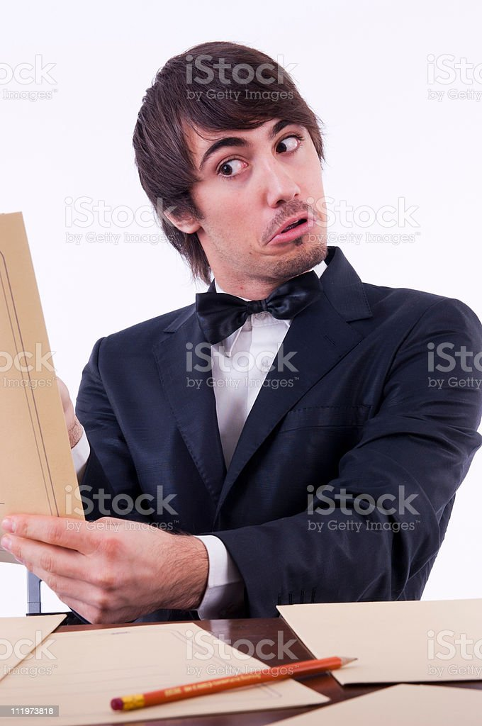 Businessman stressed in his office, many documents on the desk royalty-free stock photo