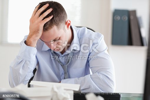 690496350istockphoto Businessman stressed while doing his accounting 826505276