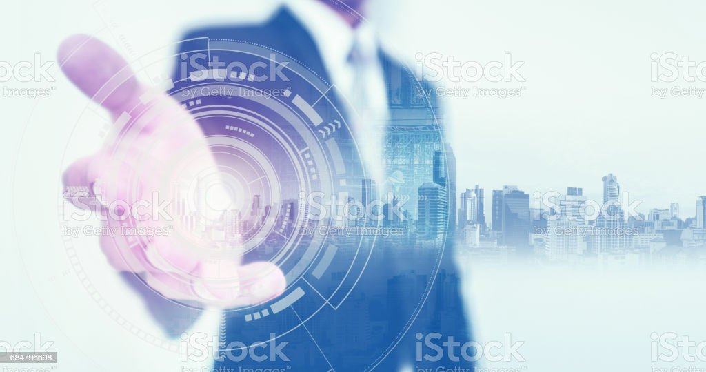 Businessman stretch out hand, with buildings hologram and futuristic interface technology stock photo