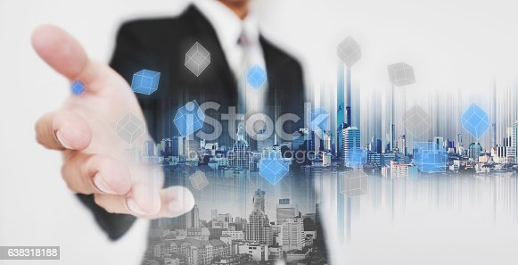 635942136istockphoto Businessman stretch out hand, with double exposure city technology 638318188