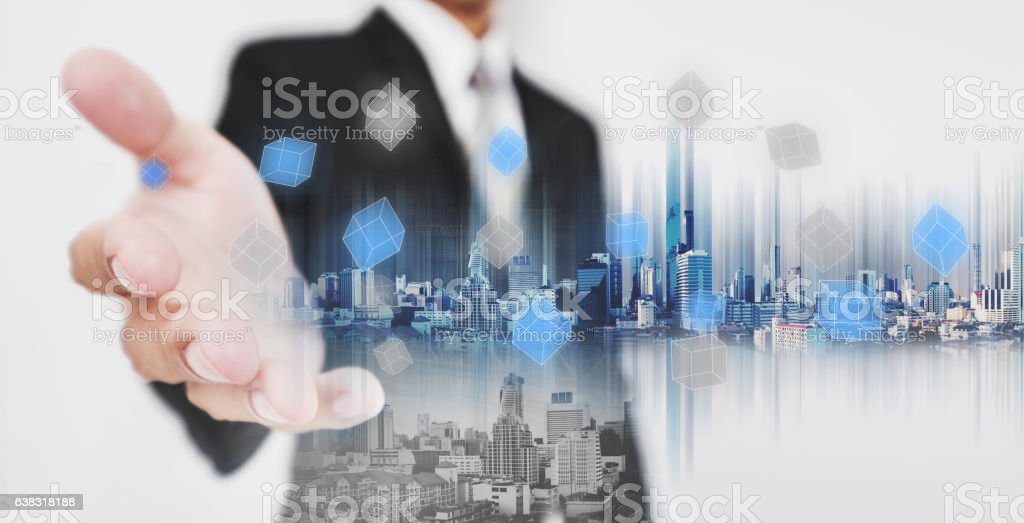 Businessman stretch out hand, with double exposure city technology stock photo