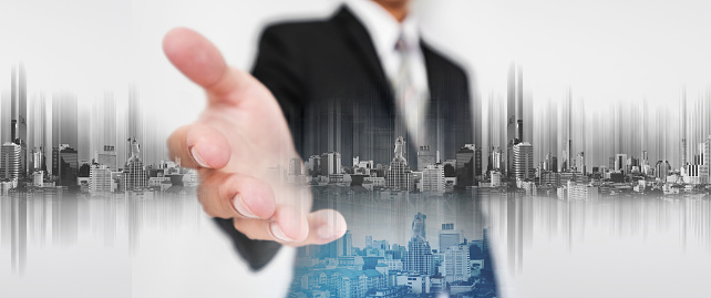 635942136 istock photo Businessman stretch out hand, with double exposure futuristic city 639093480