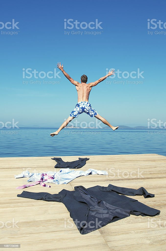 Businessman Strips Down and Leaps into the Sea royalty-free stock photo