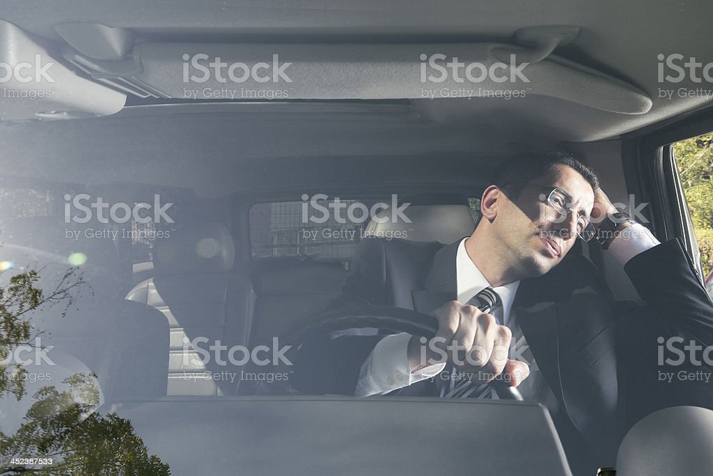 A businessman stuck in morning traffic stock photo