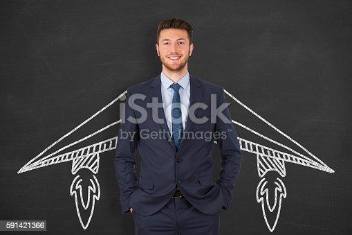 istock Businessman Success Concept Start on Chalkboard Background 591421366