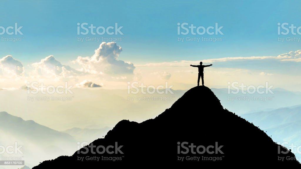 Businessman success raising arms stand on top of hill royalty-free stock photo