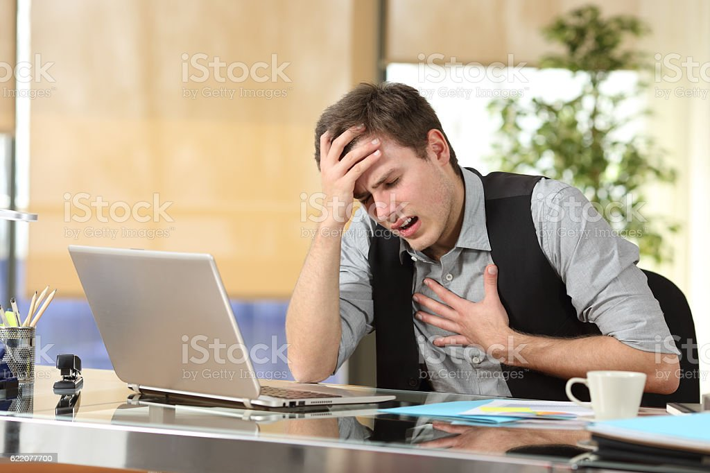 Businessman suffering an anxiety attack stock photo